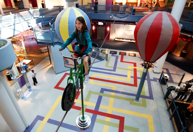 CTY imagine22p Lynsey Garber, 10, a fifth grader at Ottawa River Elementary, rides the high wire bike at Imagination Station, Wednesday, March 21, 2012. The Blade/Andy Morrison